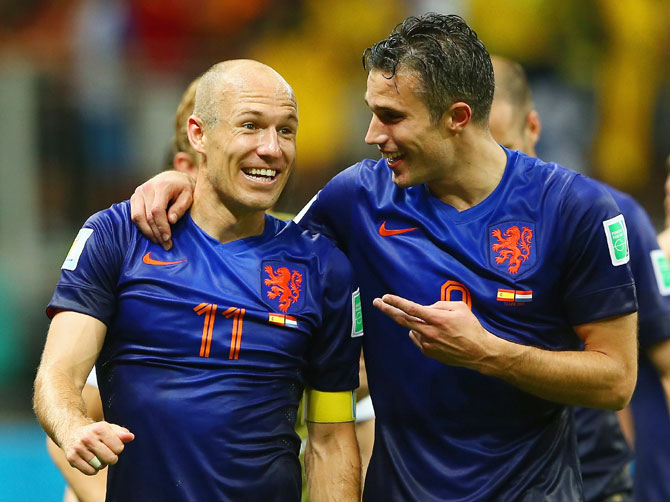 Arjen Robben (left) and Robin van Persie of the Netherlands walk off the field