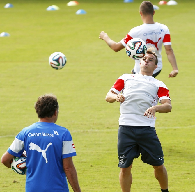 Switzerland's national soccer team player Xherdan Shaqiri, centre, controls the ball during a World Cup 2014 training session at the stadium in Porto Seguro