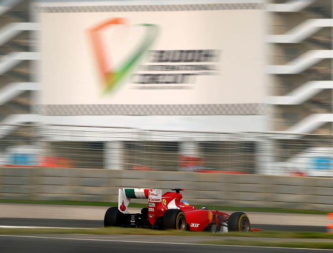 Ferrari's Fernando Alonso drives during qualifying for the 2011 Indian Formula One Grand Prix at the Buddh International Circuit in Noida.