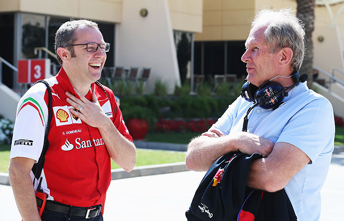 Ferrari Team Principal Stefano Domenicali (left) and Red Bull Motorsport Consultant Dr Helmut Marko  talk in the paddock