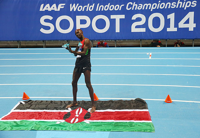 Caleb Mwangangi Ndiku of Kenya shows of his shoes as he celebrates winning gold in the Men's 3000m Final on Day 3 of the IAAF World Indoor Championships on Sunday