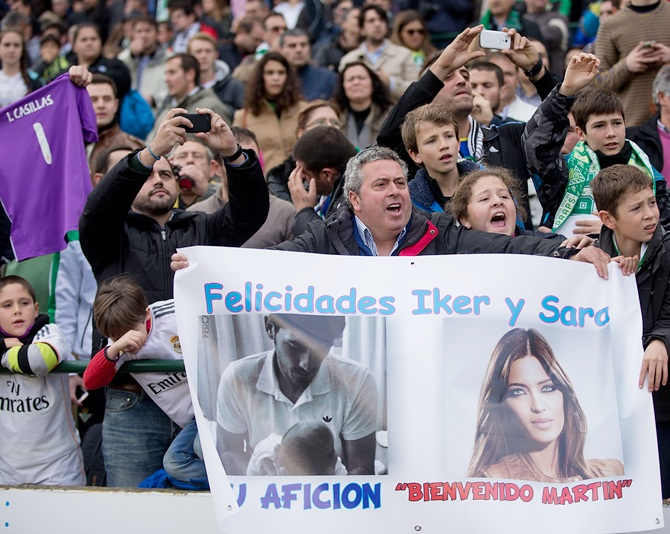 Real Madrid fans display a banner congratulating goalkeeper Iker Casillas and his girlfriend Sara Carbonero on their first son, Martin