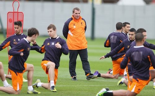 Liverpool manager Brendan Rodgers watches his players train