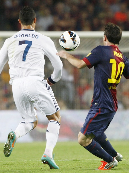 Barcelona's Lionel Messi (right) and Real Madrid's Cristiano Ronaldo
