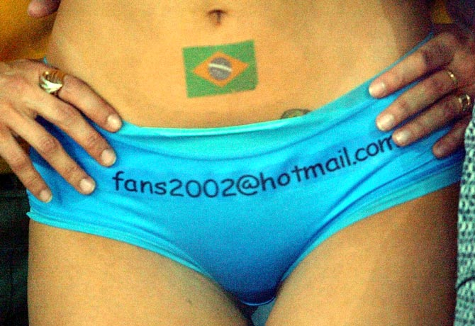 A soccer fan with a Brazil flag painted on her body
