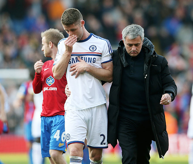 Chelsea manager Jose Mourinho consoles a dejected Gary Cahill following their 1-0 defeat to Crystal Palace during their English Premier League match at Selhurst Park in London on Saturday
