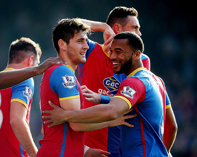 Joe Ledley and Adrian Mariappa of Crystal Palace celebrate after taking the lead against Chelsea on Saturday
