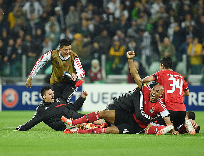 Luisao (right) of Benfica celebrates with teammates at the end of their UEFA Europa League semi-final against Juventus at Juventus Arena in Turin on Thursday