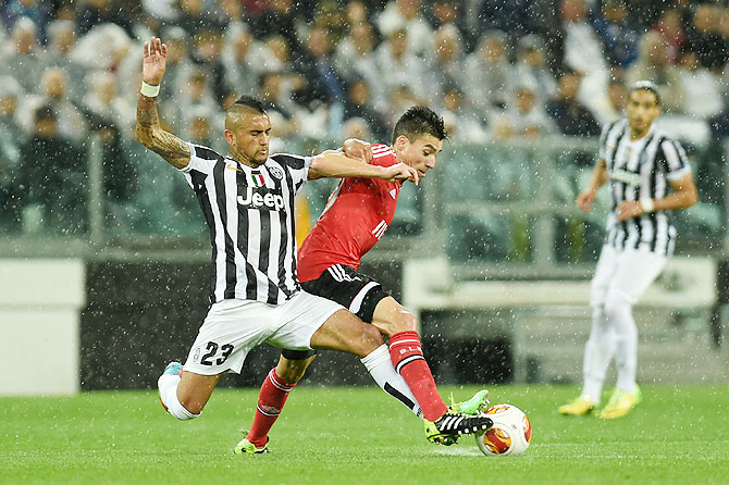 Arturo Vidal (left) of Juventus tackles Andre Gomes of Benfica during their Europa League semi-final on Thursday