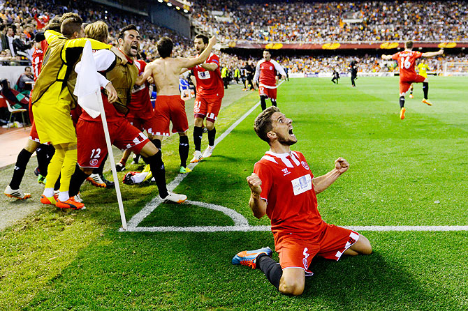 Daniel Carrico of Sevilla FC celebrates after winning the semi-final on Thursday