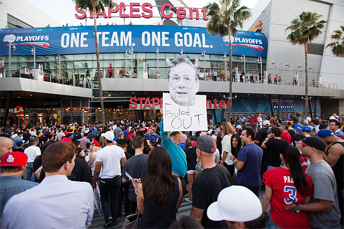 A photo cutout of Los Angeles Clippers owner Donald Sterling is seen among people standing in line for the NBA playoff game 5 between Golden State Warriors and Los Angeles Clippers at Staples Center in Los Angeles, California on Tuesday