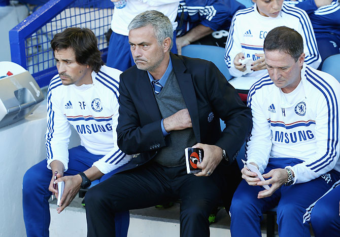 Chelsea Manager Jose Mourinho (centre) with assistants Rui Faria (left) and Steve Holland