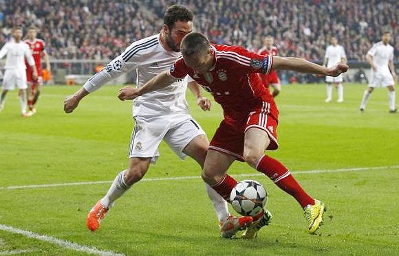 Bayern Munich's Franck Ribery (right) and Real Madrid's Daniel Carvajal fight for the ball during their Champions League semi-final second leg match in Munich on April 29