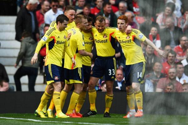 Sebastian Larsson (third from left) of Sunderland is congratulated by teammates after scoring against Manchester United