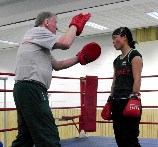 MC Mary Kom (right) with her coach, Charles Atkinson