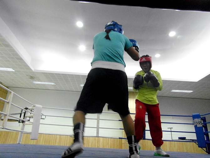 MC Mary Kom (right) during a training bout against Jamuna Devi
