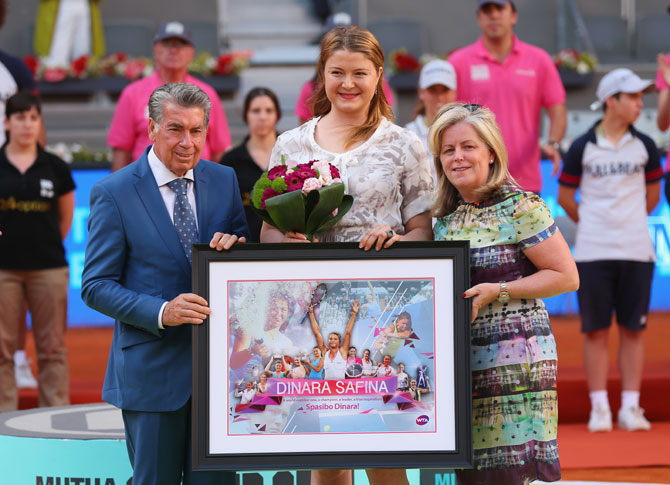 Dinara Safina of Russia poses for a photograph after announcing her retirement with Stacey Allaster, CEO of the WTA Tour and Manolo Santana, tournament director