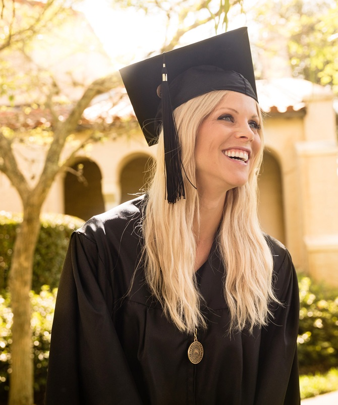 Elin Nordegren receives the   Hamilton Holt Outstanding Senior Award for the Class of 2014 during her graduation from Rollins College