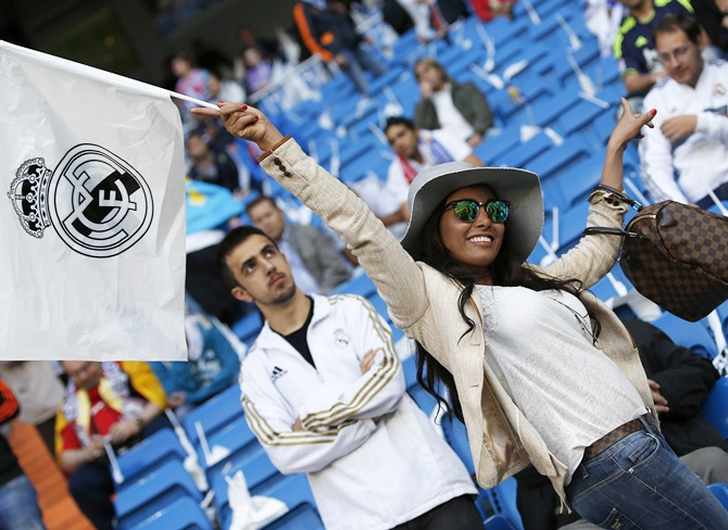 A Real Madrid fan waves her flag