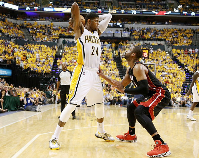 Indiana Pacers forward Paul George (24) works around the defense of Miami Heat guard Dwyane Wade (3) during the fourth quarter in game five of the Eastern Conference Finals of the 2014 NBA Playoffs at Bankers Life Fieldhouse on Wednesday