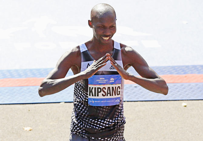 Wilson Kipsang of Kenya celebrates after crossing the finish line to win theNew York City Marathon in Central Park on Sunday
