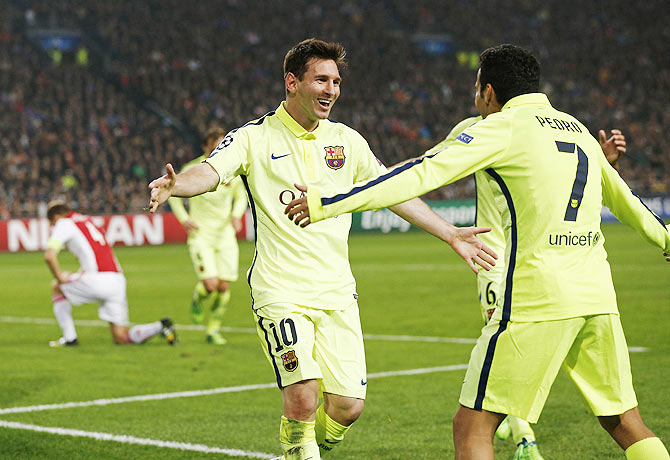 Barcelona's Lionel Messi celebrates his goal with teammate Pedro Rodriguez (R) during their Champions League Group F soccer match