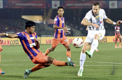 Atletico de Kolkata (white) and FC Pune City players in action during their ISL match in Kolkata on Friday