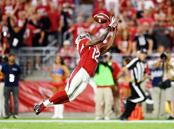 Arizona Cardinals wide receiver John Brown (12) catches a touchdown pass in the fourth quarter against the St. Louis Rams at University of Phoenix Stadium