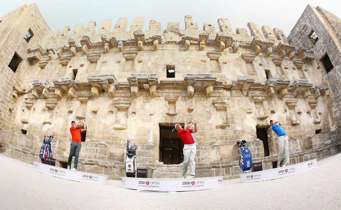 Sergio Garcia of Spain, Henrik Stenson of Sweden and Lee Westwood of England take on the challenge to hit golf balls over the towering walls of the 2,000 year-old Amphitheater of Aspendos