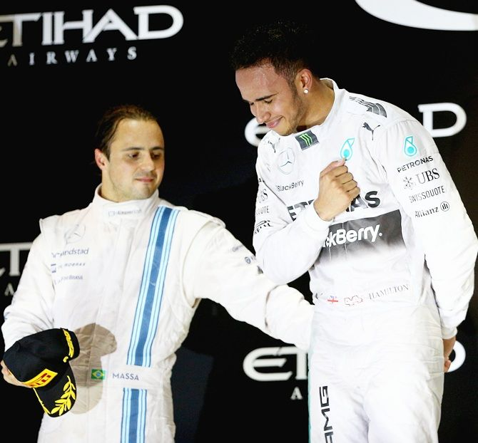 Lewis Hamilton of Great Britain and Mercedes GP celebrates on the podium next to Felipe   Massa of Brazil