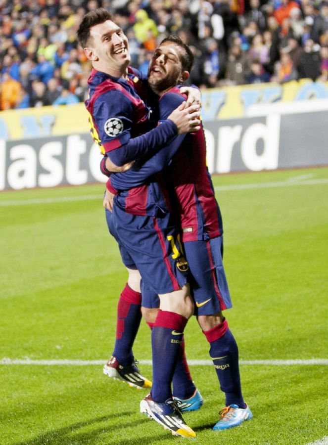 Barcelona's Lionel Messi (left) celebrates after scoring against APOEL Nicosia during their Champions League Group F soccer match at GSP Stadium in Nicosia on Tuesday