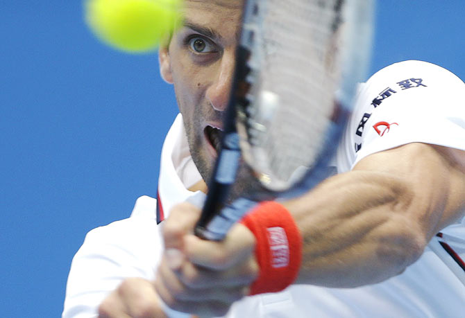 Novak Djokovic of Serbia returns the ball during his men's quarter-final match against Grigor Dimitrov of Bulgaria at the China Open tennis tournament in Beijing on Friday
