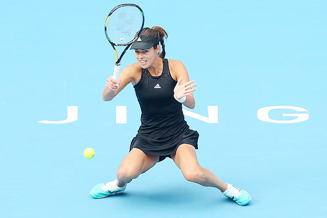 Ana Ivanovic of Serbia plays a forehand in her match against Sabine Lisicki of Germany at the China Open on Thursday