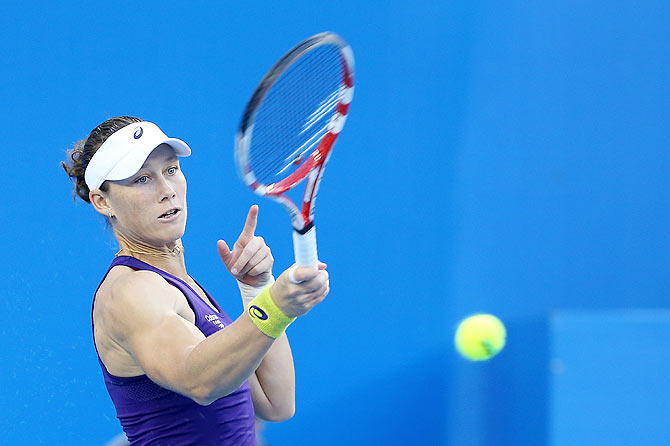 Samantha Stosur of Australia returns a shot against Alize Cornet of France during day six of the China Open