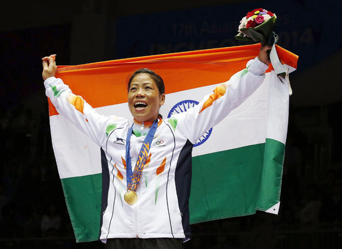 India's gold medallist MC Mary Kom reacts during the medal ceremony for the women's fly (48-51kg) boxing competition