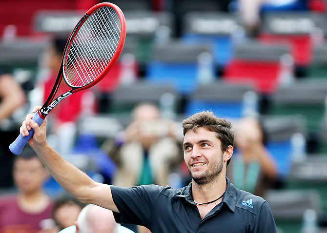 Gilles Simon of France reacts after winning his match against Tomas Berdych of the Czech Republic in Shanghai on Friday
