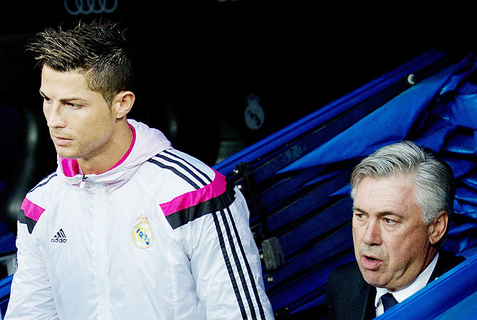 Cristiano Ronaldo (left) of Real Madrid with head coach Carlo Ancelotti