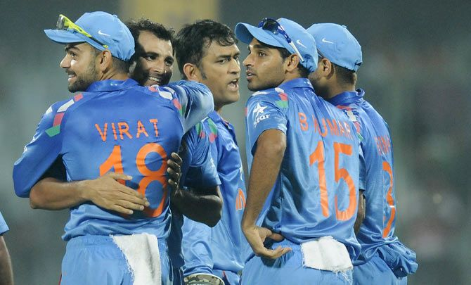 India cricketes Virat Kohli, Mohammad Shami, MS Dhoni and Bhuvaneshwar Kumar celebrate a wicket