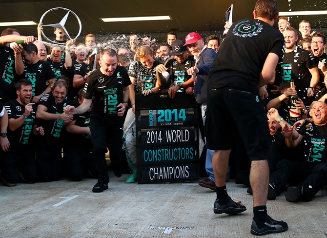 The Formula One constructors' world championship trophy found a new   home just down the road from Red Bull's factory in England on Sunday as Mercedes celebrated a   historic first for their 'Silver Arrows' team