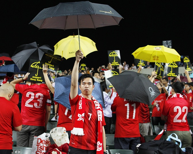 Occupy Central supporters hold up umbrellas