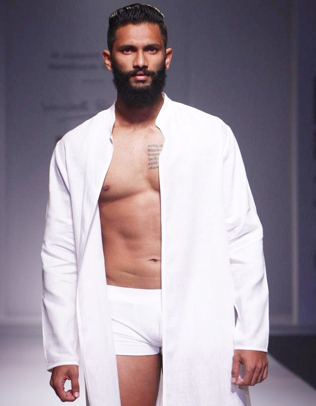 Prathamesh Maulingkar poses during the Wills Lifestyle India Fashion Week (WIFW) in New Delhi in 2014