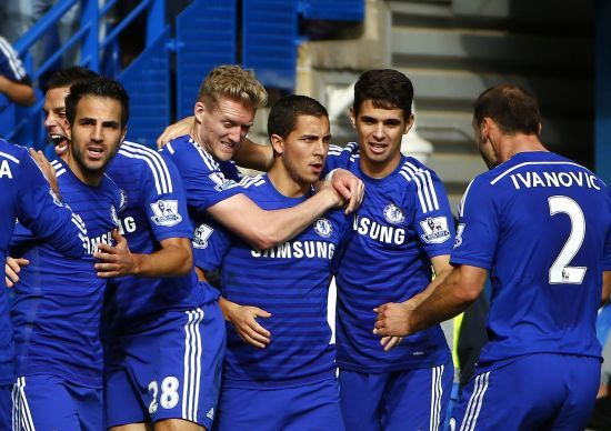 Chelsea's Eden Hazard (centre) celebrates with teammates after scoring a penalty against Arsenal