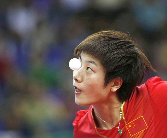 China's Ding Ning serves
