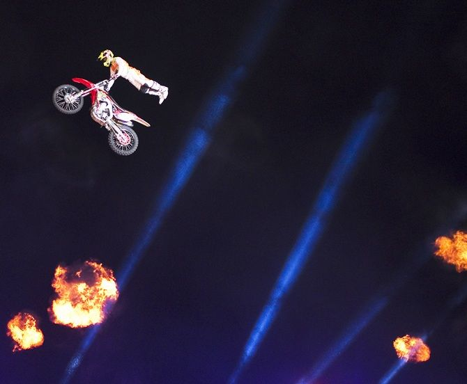 A rider performs motorcycle stunts