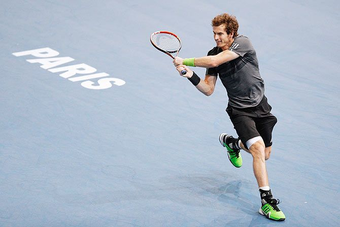 Andy Murray of Great Britain in action against Julien Benneteau of France