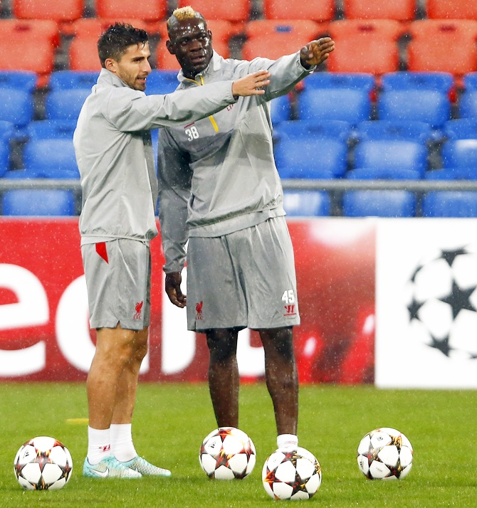 Liverpool's Mario Balotelli and teammate Fabio Borini