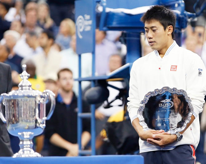 Kei Nishikori with his runners-up trophy