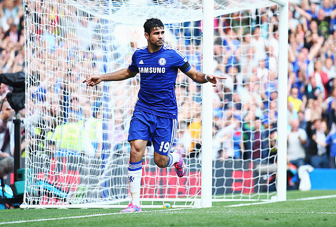 Diego Costa celebrates after scoring against Swansea