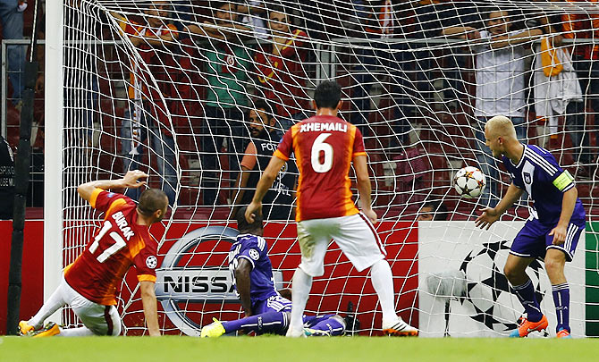 Burak Yilmaz of Galatasaray (L) scores against Anderlecht during their Champions League Group D soccer match in Istanbul on Tuesday