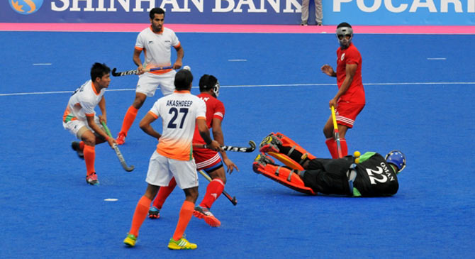 Action in the Asian Games match between India and Oman
